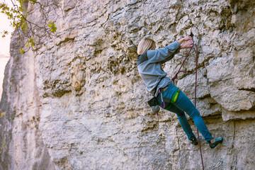 A woman climber on a rock.