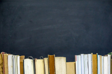 Books with chalkboard background. Education concept.
