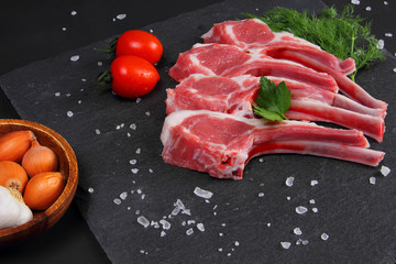 Raw Beef with Bones on the Black Background