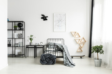 Simple bedroom with black bed