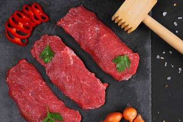 Raw Meat Pieces on the Black Background