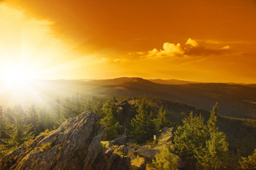 Summer landscape at sunset in National park Bayerische Wald,  view from the mountain Grosser Arber, Germany.