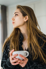 Beautiful model with cup of coffee