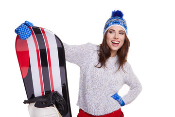 Woman wearing winter suit holding a snowboard in studio