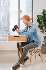 Photographer working at desk in modern office