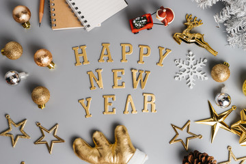 Christmas holiday background with gold ornaments and decorations. Merry christmas and happy new year greeting card with copy space. Christmas celebration holiday background.