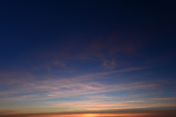 Sunset in the blue cloudless winter sky at dusk before the nightfall