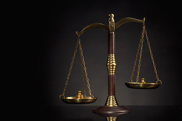 Wooden Judges gavel ,golden scales of justice. Legal office.