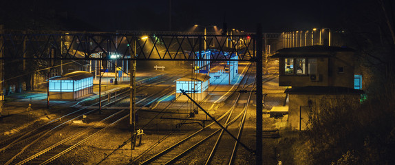 RAYLWAY STATION - A railway track in a small city at night