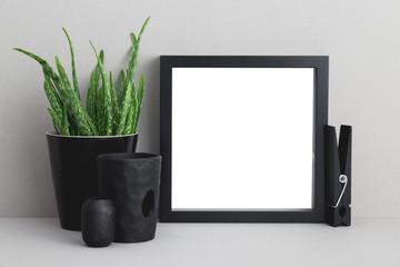 Photo frame and a flower on a shelf mock up.