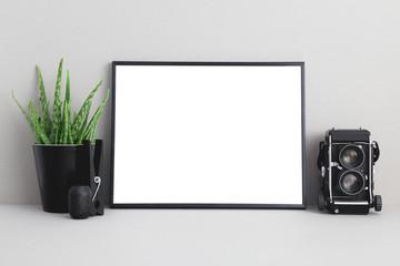Blank photo frame mock up and flower on shelf.