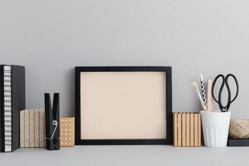 Photo frame on a grey office desk. Mock up