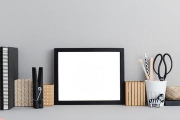 Frame on a desk mock up.