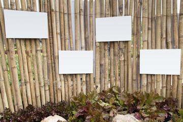 empty board on bamboo wall