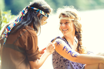 Pretty free hippie girls. Body painting - Vintage effect photo