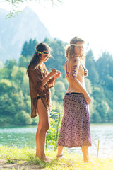 Pretty free hippie girls. Body painting. Lake view - Vintage effect  photo