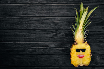 Fashion Hipster Pineapple Fruit. Tropical pineapple with Sunglasses. Creative Art concept. Top view. Free space for text.
