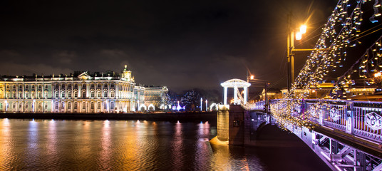 View of Winter Palace, Neva River and New Year's decorations on Palace Bridge, Saint Petersburg, Russia