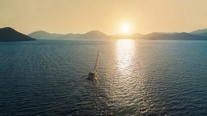 Boat sailing into the sun in Mediterranean Sea