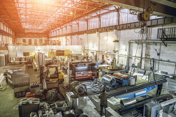 Interior of manufacturing metalworking factory warehouse with  modern equipment tools and machines