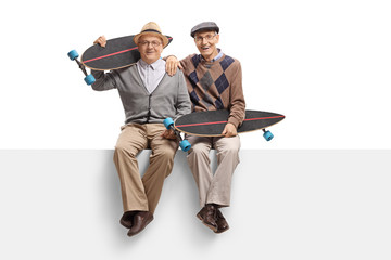 Seniors with longboards sitting on a panel