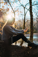 Charming woman taking selfie in fall woods