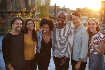 Group portrait of friends at a rooftop party in Brooklyn