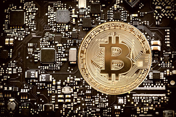 Digital currency bitcoin on computer chip