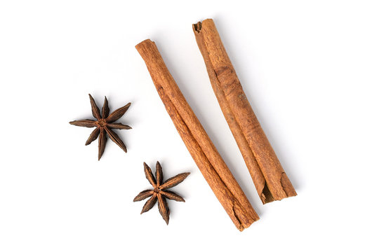 Two brown vegeterian cinnamon sticks lying on white background