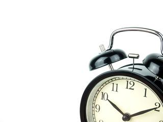 Alarm Clock on white, showing ten o'clock on white background