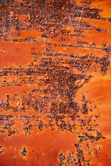 Rusty metal surface with cracked red paint, abstract rusty metal texture, rusty metal background...