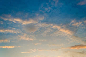 Wall Mural - There is a golden light below the horizon. dramatic sky with cloud at sunset,in the morning