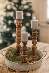 Wooden candleholders with gray candles