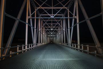 Empty bridge against clear sky at night