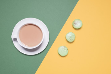 High angle view of coffee and macaroons on table