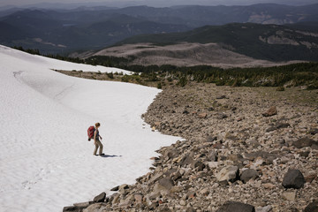High angle view of woman on snowcapped mountain during sunny day