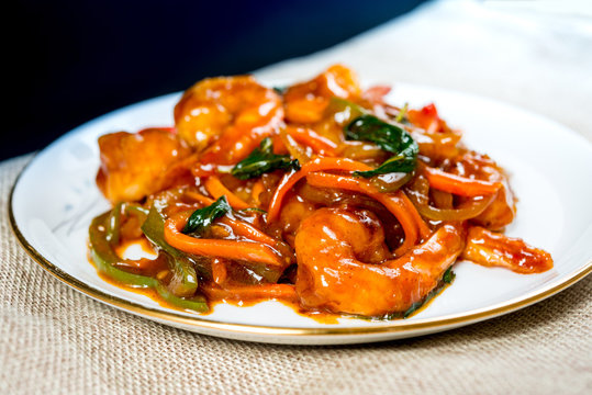 wok fried Shrimp stir fry with sweet peppers and chinese vegetables