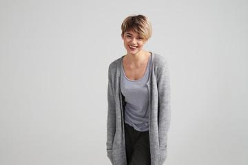 Smiling woman with short haircut looking at camera