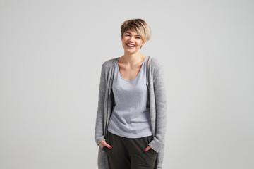 Positive woman with short haircut smiling at camera