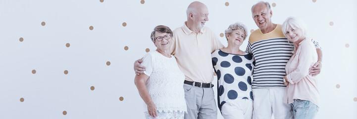 Enthusiastic elderly friends celebrating meeting