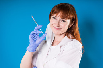 Woman doctor smiling with syringe in hand