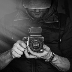A man with a camera. Black and white photography