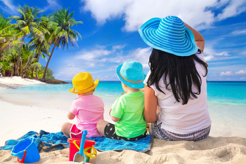 Mother with twins on the tropical beach holidays
