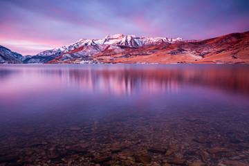 Winter dawn reflection in Deer Creek, Utah, USA.