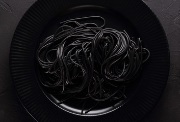 Black pasta in the black plate