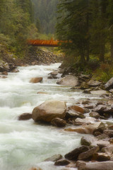 Mountain river with a woody bridge nearby Krimml, Austria