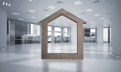 Conceptual background image of concrete home sign in modern office interior