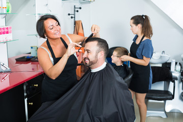 hairdresser and client in beauty salon .