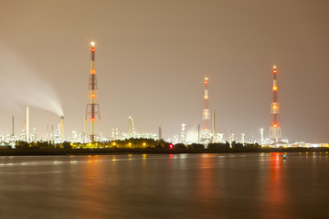 Refinery And Flare Stack At Night