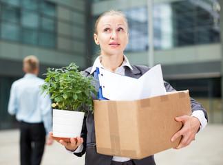 Businesswoman is standing pensive near office
